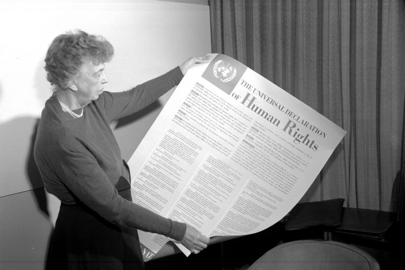 Female Eleanor Roosevelt holding up universal declaration of human right document